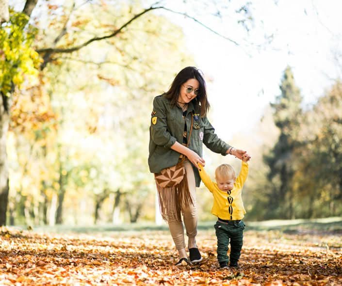 Image of mother and little boy walking in park