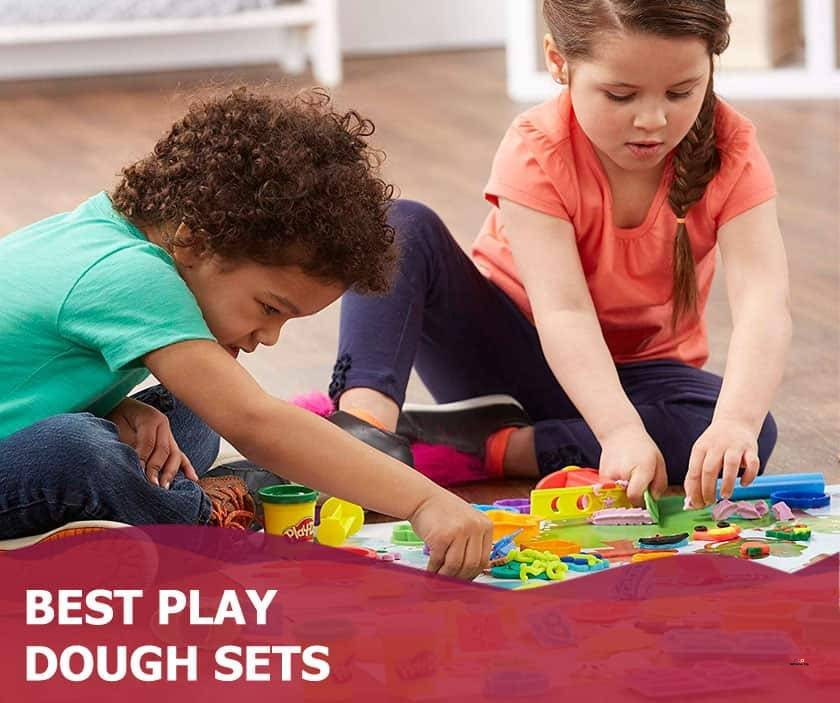 Featured image of boy and girl playing with play dough on floor
