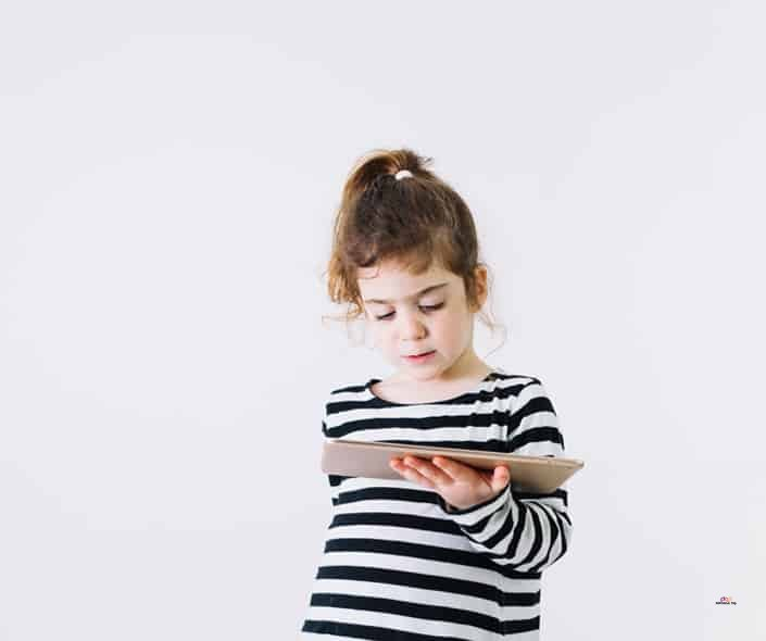 Featured image of little girl in black and white watching tablet