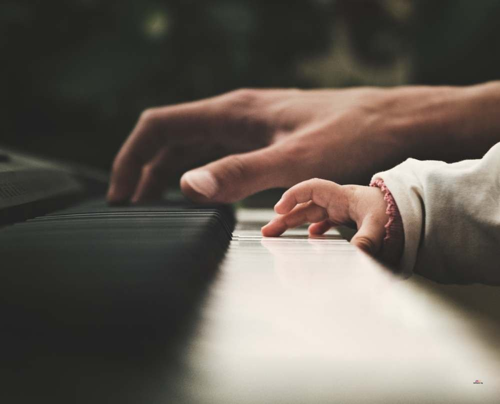 little girl playing a piano